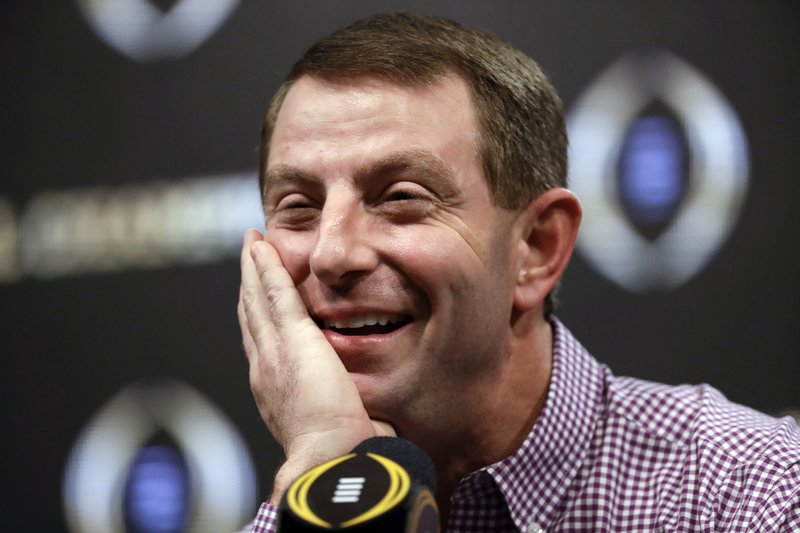 FILE - In this Jan. 8, 2019, file photo, Clemson head coach Dabo Swinney answers questions at a news conference for the NCAA college football playoff championship game, in San Jose, Calif. (AP Photo/David J. Phillip, File)