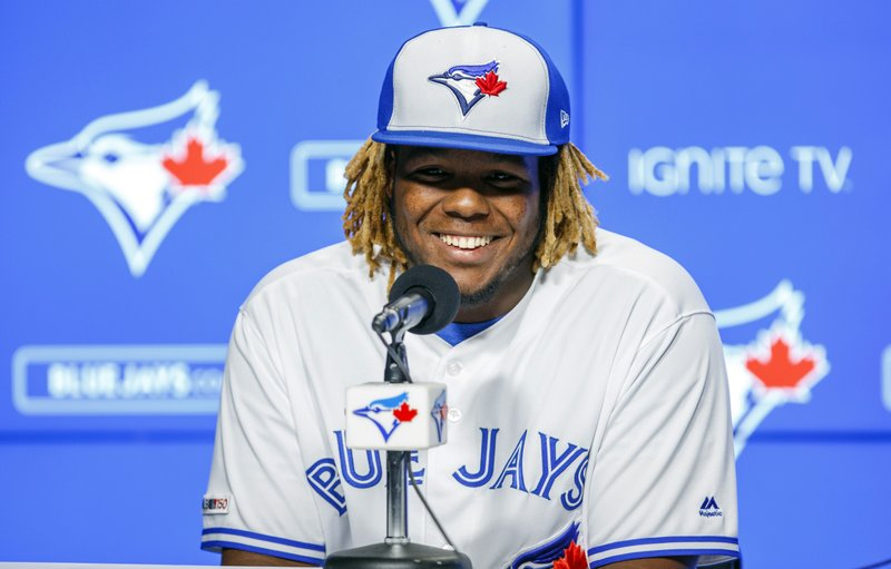 Toronto Blue Jays rookie Vladimir Guerrero Jr. speaks at a news conference before his major league debut against the Oakland Athletics in a baseball game in Toronto, Friday, April 26, 2019. (Mark Blinch/The Canadian Press via AP)