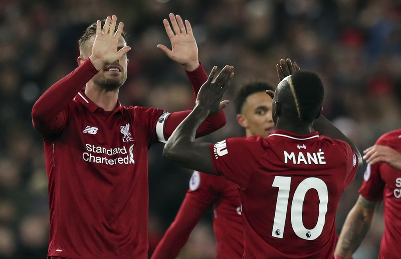 Liverpool's Sadio Mane,right, celebrates after scoring his side's fourth goal during the English Premier League soccer match between Liverpool and Huddersfield Town at Anfield Stadium, in Liverpool, England, Friday, April 26, 2019.(AP Photo/Jon Super)