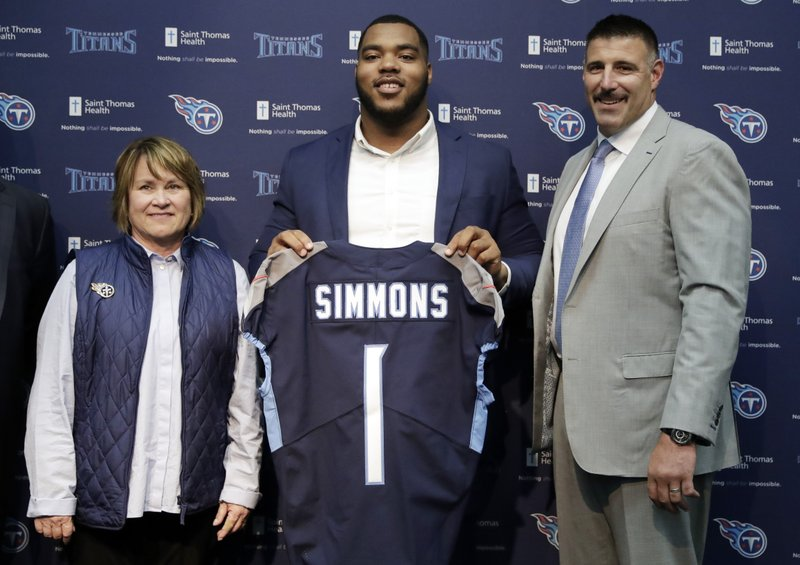 Mississippi State defensive tackle Jeffery Simmons, center, poses with Tennessee Titans owner Amy Adams Strunk, left, and head coach Mike Vrabel, right, during an NFL football news conference Friday, April 26, 2019, in Nashville, Tenn. (AP Photo/Mark Humphrey)