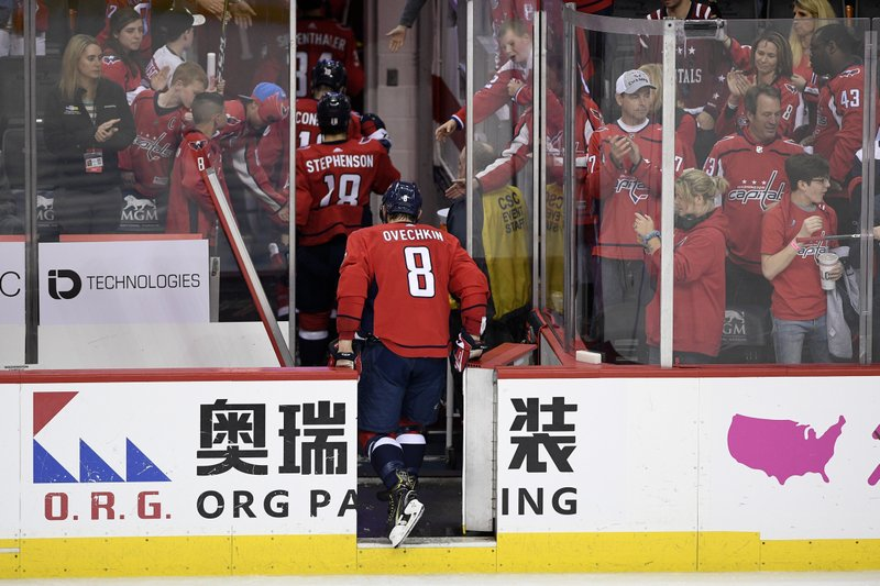 Washington Capitals left wing Alex Ovechkin (8), of Russia, leaves the ice after Game 7 of an NHL hockey first-round playoff series against the Carolina Hurricanes, Wednesday, April 24, 2019, in Washington. (AP Photo/Nick Wass)