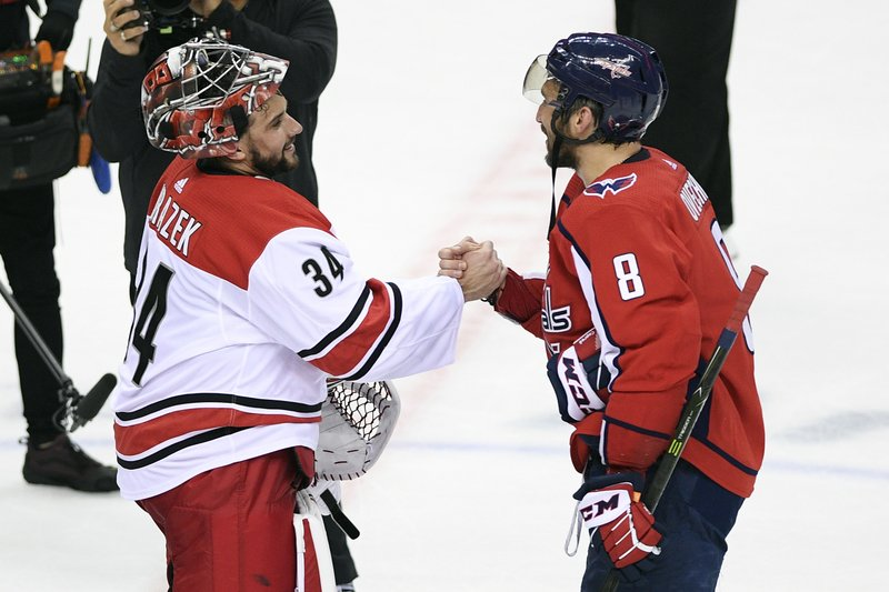 Carolina Hurricanes goaltender Petr Mrazek (34), of the Czech Republic, shakes hands with Washington Capitals left wing Alex Ovechkin (8), of Russia, after Game 7 of an NHL hockey first-round playoff series, Wednesday, April 24, 2019, in Washington. (AP Photo/Nick Wass)