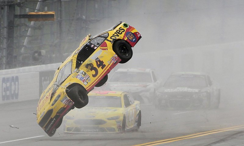 FILE - In this May 1, 2016, file photo, Chris Buescher (34) wrecks during the NASCAR Talladega auto race at Talladega Superspeedway, in Talladega, Ala. (AP Photo/Greg McWilliams, File)