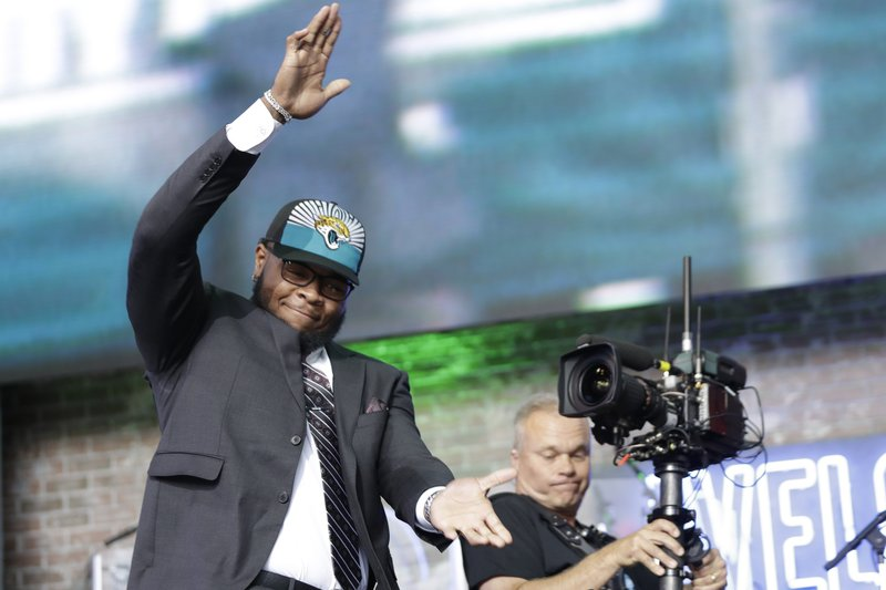 Florida's Jawaan Taylor enters the stage after the Jacksonville Jaguars selected Taylor in the second round of the NFL football draft, Friday, April 26, 2019, in Nashville, Tenn.(AP Photo/Mark Humphrey)