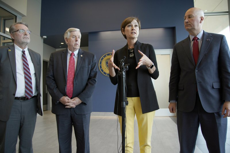 Iowa Gov. Kim Reynolds, second right, Nebraska Gov. Pete Ricketts, right, Missouri Gov. Mike Parson, and Kansas Lt. (AP Photo/Nati Harnik)