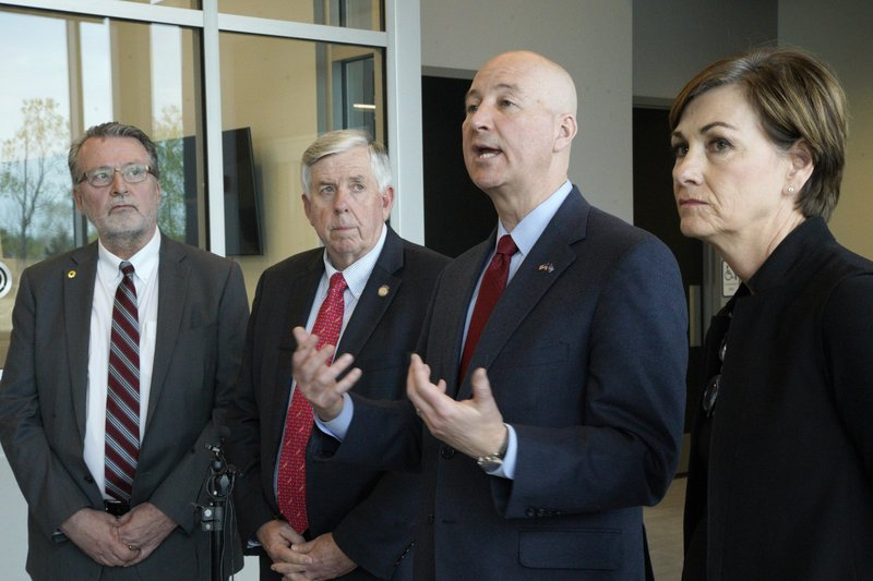 Iowa Gov. Kim Reynolds, right, Nebraska Gov. Pete Ricketts, second right, Missouri Gov. Mike Parson, and Kansas Lt. (AP Photo/Nati Harnik)