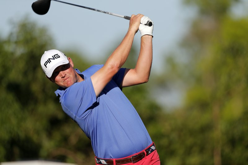 Trey Mullinax hits off the second tee during the second round of the PGA Zurich Classic golf tournament at TPC Louisiana in Avondale, La. (AP Photo/Gerald Herbert)