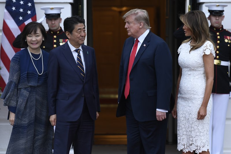 President Donald Trump, third from right, and first lady Melania Trump, second from right, welcome Japanese Prime Minister Shinzo Abe, third from left, and his wife Akie Abe, left, to the South Lawn of the White House in Washington, Friday, April 26, 2019. (AP Photo/Susan Walsh)