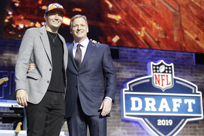 Missouri quarterback Drew Lock poses with NFL Commissioner Roger Goodell after the Denver Broncos selected Lock in the second round of the NFL football draft, Friday, April 26, 2019, in Nashville, Tenn. (AP Photo/Mark Humphrey)
