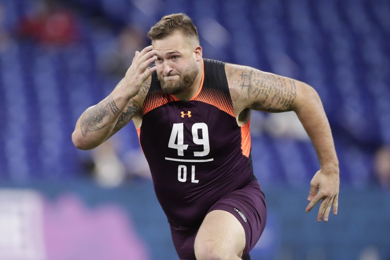 FILE - In this March 1, 2019, file photo, Kansas State offensive lineman Dalton Risner runs a drill at the NFL football scouting combine in Indianapolis. (AP Photo/Michael Conroy, File)