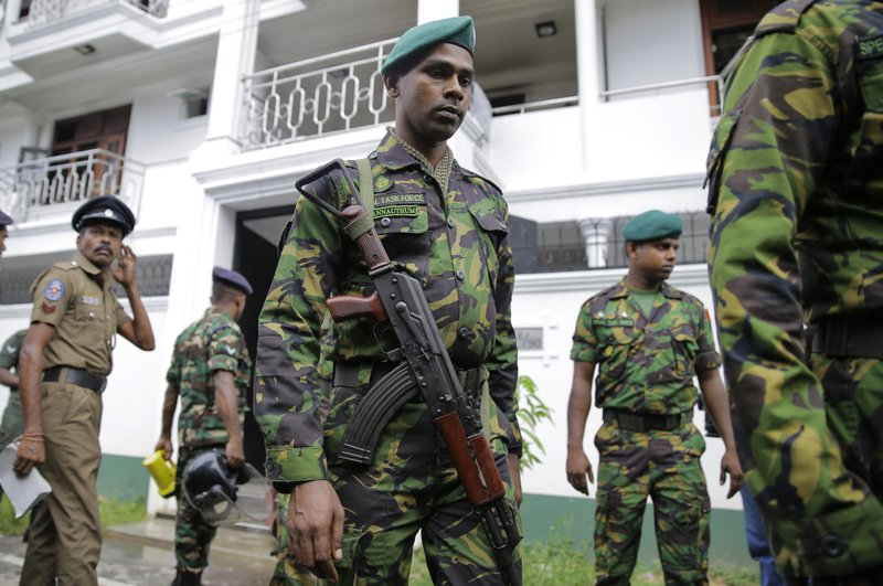FILE- In this April 21, 2019, file photo, Sri Lankan security forces officers secure a site believed to be a hide out of the militants following a shoot out in Colombo, Sri Lanka. (AP Photo/Eranga Jayawardena, File)