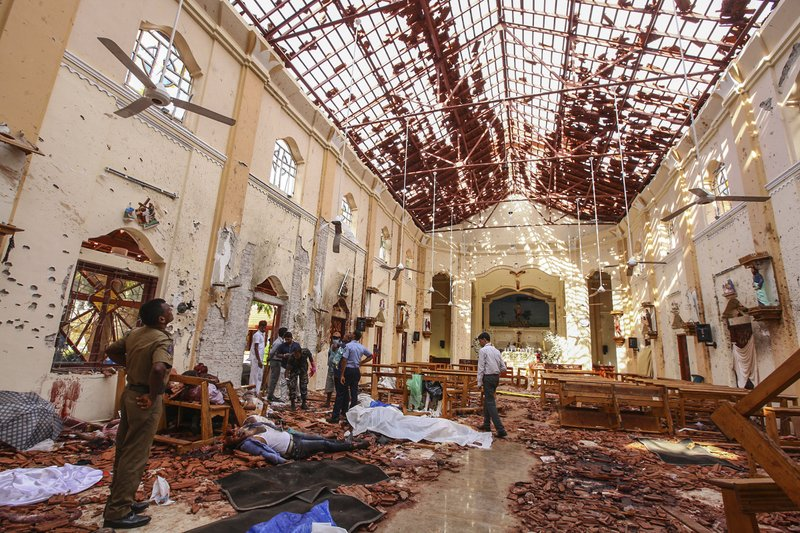 EDS NOTE: GRAPHIC CONTENT - FILE- In this April 21, 2019, file photo, dead bodies of victims lie inside St. (AP Photo/Chamila Karunarathne, File)