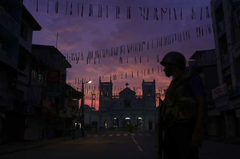 A Sri Lankan Army soldier stands guard in front St. Anthony's Church in Colombo, Sri Lanka, Friday, April 26, 2019. (AP Photo/Manish Swarup)