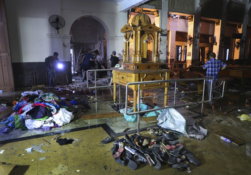 Shoes and other belongings left by panicked worshippers are seen stacked up inside St. Anthony's Church in Colombo, Sri Lanka, Friday, April 26, 2019. (AP Photo/Manish Swarup)