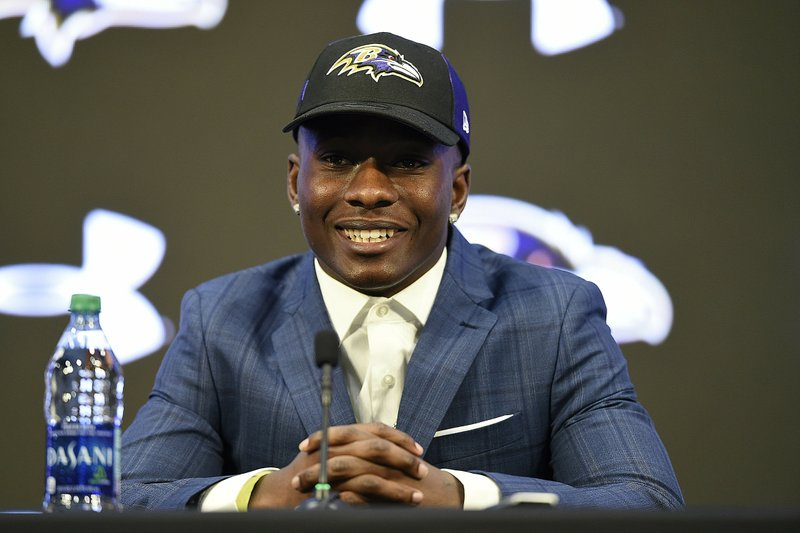 Baltimore Ravens NFL football first round draft pick Marquise Brown answers questions during a news conference, Friday, April 26, 2019, in Owings Mills, Md. (AP Photo/Gail Burton)