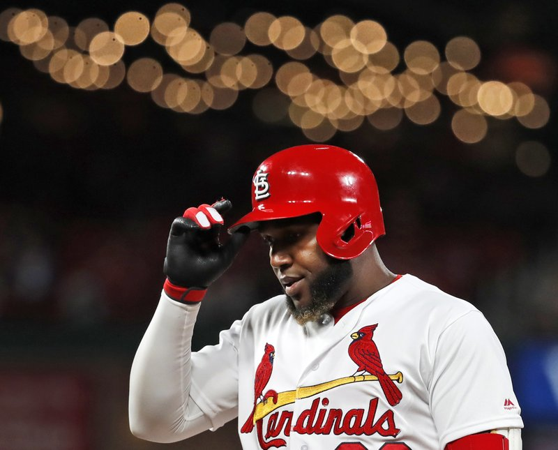 St. Louis Cardinals' Marcell Ozuna removes his helmet after popping out to end the seventh inning of a baseball game against the Cincinnati Reds Friday, April 26, 2019, in St. (AP Photo/Jeff Roberson)