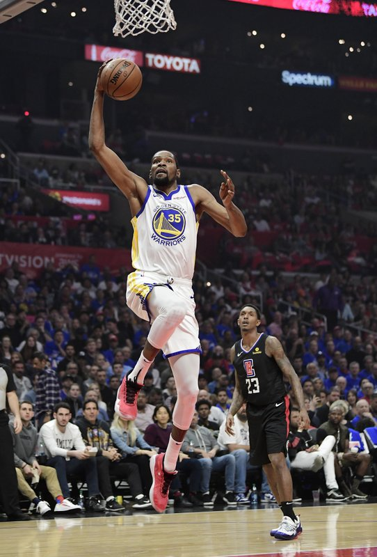 Golden State Warriors forward Kevin Durant, left, shoots as Los Angeles Clippers guard Lou Williams defends during the first half in Game 6 of a first-round NBA basketball playoff series Friday, April 26, 2019, in Los Angeles. (AP Photo/Mark J. Terrill)