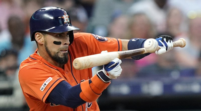Houston Astros' Robinson Chirinos bunts for a single against the Cleveland Indians during the second inning of a baseball game Friday, April 26, 2019, in Houston. (AP Photo/David J. Phillip)