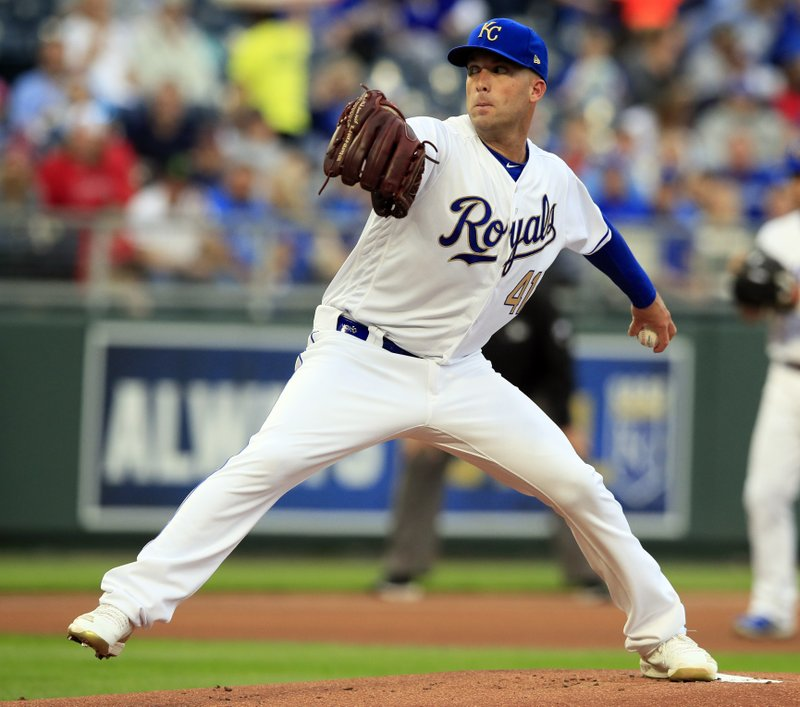 Kansas City Royals starting pitcher Danny Duffy delivers to a Los Angeles Angels batter during the first inning of a baseball game at Kauffman Stadium in Kansas City, Mo. (AP Photo/Orlin Wagner)