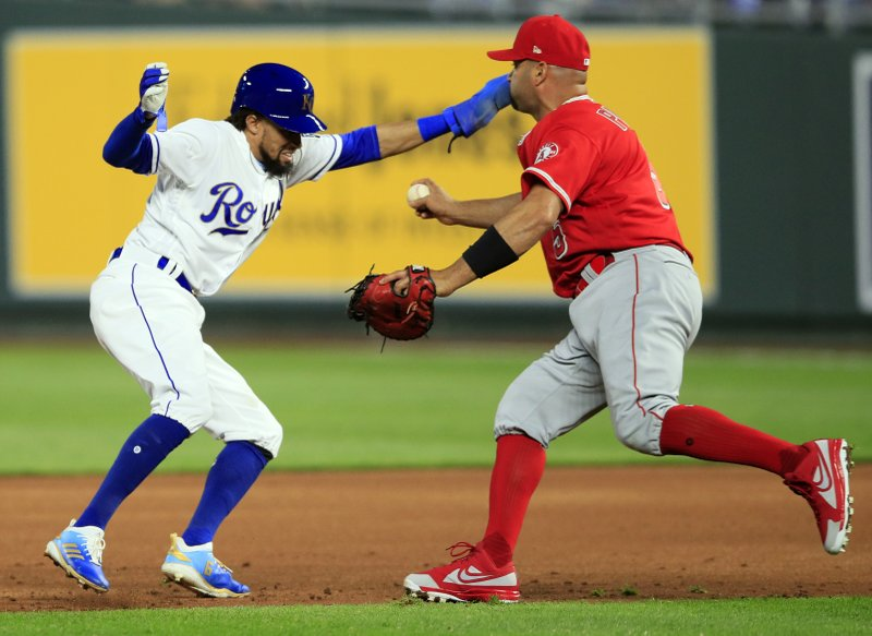 Los Angeles Angels first baseman Albert Pujols, right, tags out Kansas City Royals' Billy Hamilton, left, in a rundown during the third inning of a baseball game at Kauffman Stadium in Kansas City, Mo. (AP Photo/Orlin Wagner)