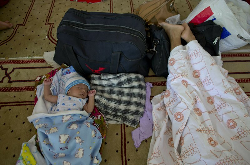 FILE - In this Thursday, April 25, 2019 file photo, ten-day-old Ahmadi Muslim infant Amdad Ahamed sleeps at a community center, where his family has taken refuge in for fear of retaliation towards their community after the Easter Sunday bombings, in Pasyala, north east of Colombo, Sri Lanka. (AP Photo/Gemunu Amarasinghe, File)