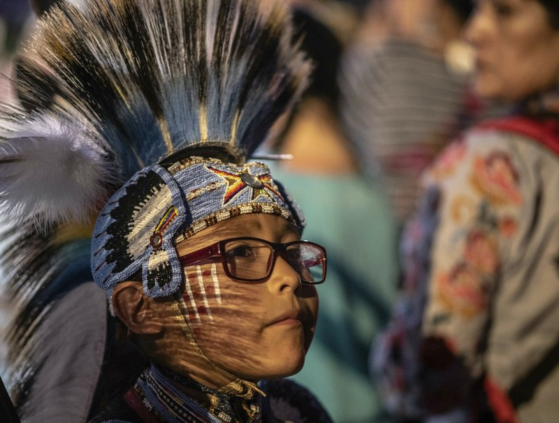 nmalj103---04/26/2019---Jim Trenton  8, of Brimhall, N.M. waits his chance to show his talent in the Junior boys Traditional category at the Gathering Of Nations in Albuquerque, N. (Roberto E. Rosales/The Albuquerque Journal via AP)
