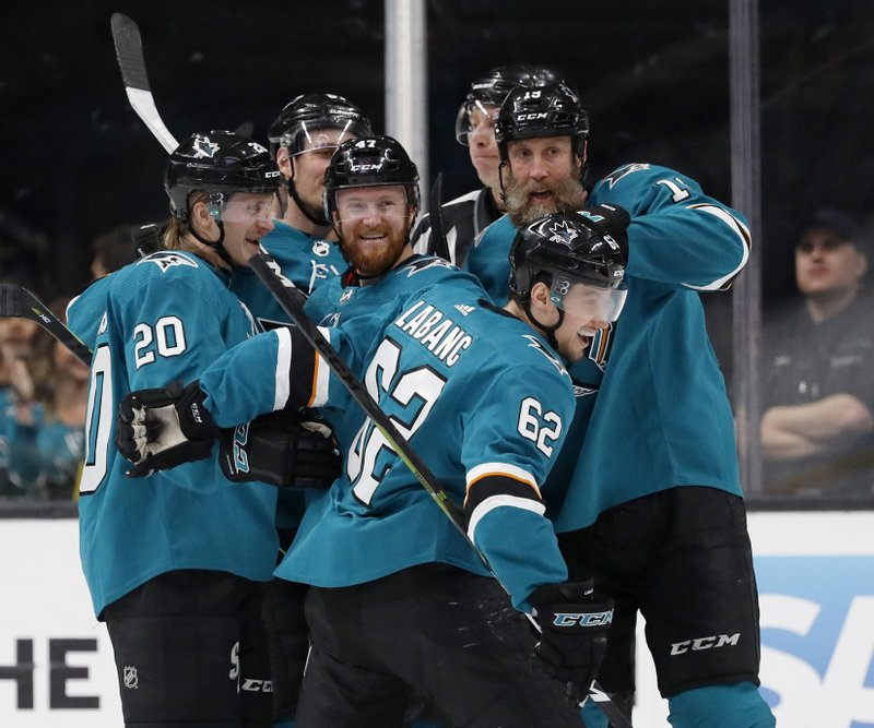 San Jose Sharks' Marcus Sorensen (20), Joakim Ryan (47), Joe Thornton (19), celebrate with Kevin Labanc (62), center, who scored goal against the Colorado Avalanche in the second period of Game 1 of an NHL hockey second-round playoff series at the SAP Center in San Jose, Calif. (AP Photo/Josie Lepe)