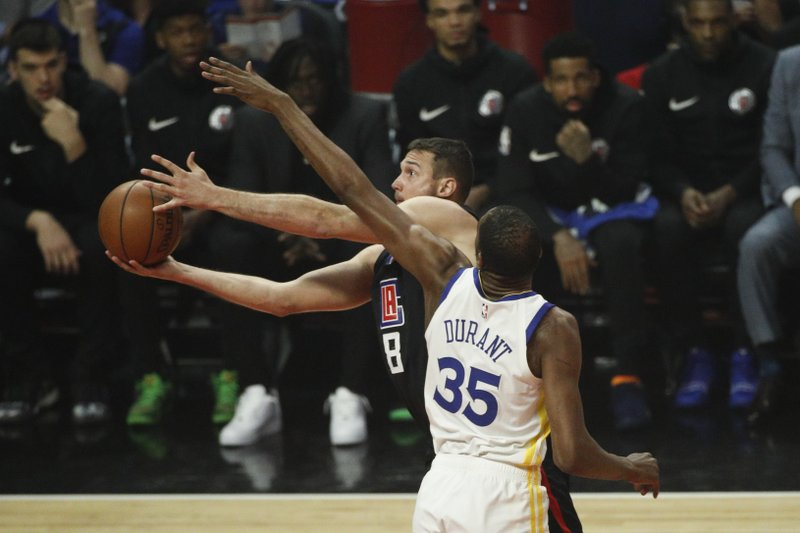 Los Angeles Clippers' Danilo Gallinari, left, drives to the basket past Golden State Warriors' Kevin Durant during the first half in Game 6 of a first-round NBA basketball playoff series Friday, April 26, 2019, in Los Angeles. (AP Photo/Jae C. Hong)