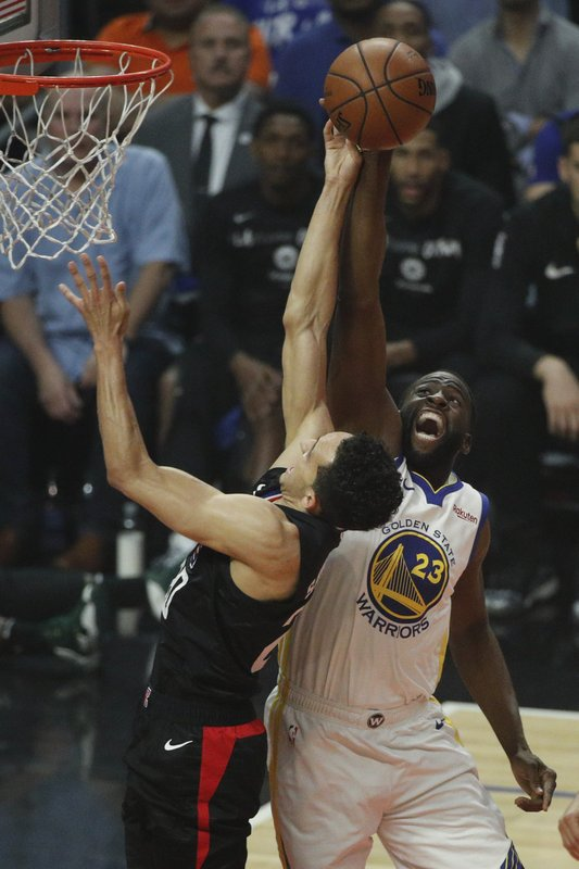 Los Angeles Clippers' Landry Shamet, left, gets his shot blocked by Golden State Warriors' Draymond Green during the first half in Game 6 of a first-round NBA basketball playoff series Friday, April 26, 2019, in Los Angeles. (AP Photo/Jae C. Hong)