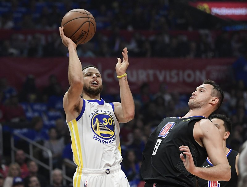 Golden State Warriors guard Stephen Curry, left, shoots as Los Angeles Clippers forward Danilo Gallinari defends during the first half in Game 6 of a first-round NBA basketball playoff series Friday, April 26, 2019, in Los Angeles. (AP Photo/Mark J. Terrill)
