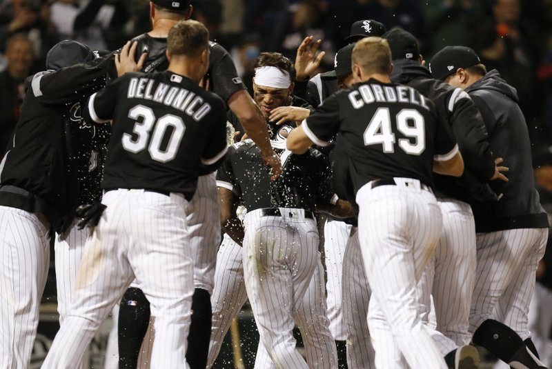 Chicago White Sox Tim Anderson (7) celebrates with teammates following his walk-off home run against the Detroit Tigers during the ninth inning of a baseball game Friday, April 26, 2019, in Chicago. (AP Photo/Nuccio DiNuzzo)