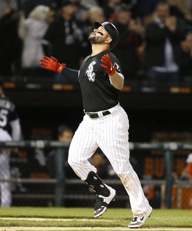 Chicago White Sox's Yonder Alonso (17) celebrates following his home run against the Detroit Tigers during the fourth inning of a baseball game Friday, April 26, 2019, in Chicago. (AP Photo/Nuccio DiNuzzo)