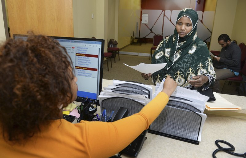 Makkiya receives paperwork for an Ethiopian Origin ID Card at the Consulate General of the Federal and Democratic Republic of Ethiopia to Minnesota and the Midwest, in St. (Scott Takushi/Pioneer Press via AP)