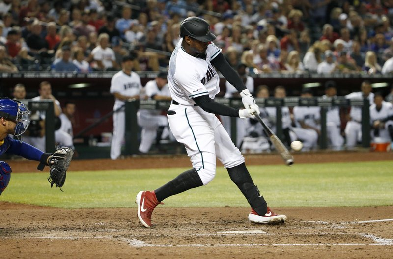 Arizona Diamondbacks' Adam Jones hits a single against the Chicago Cubs during the fifth inning of a baseball game, Friday, April 26, 2019, in Phoenix. (AP Photo/Ralph Freso)