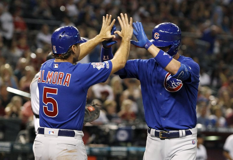 Chicago Cubs' Kris Bryant, right, is congratulated by teammate Albert Almora (5) after hitting a two-run home run against the Arizona Diamondbacks during the third inning of a baseball game, Friday, April 26, 2019, in Phoenix. (AP Photo/Ralph Freso)