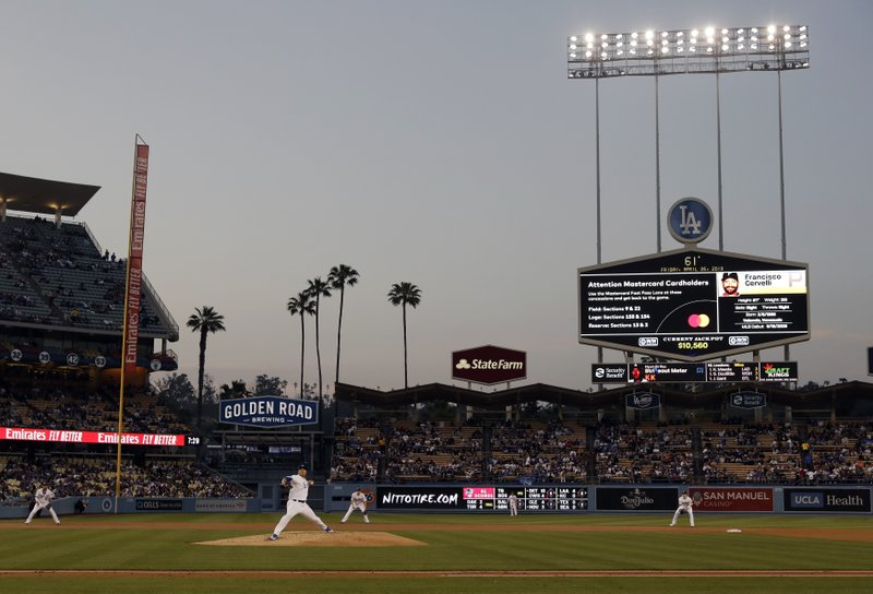 Los Angeles Dodgers starting pitcher Hyun-Jin Ryu, bottom left, throws to the Pittsburgh Pirates during the second inning of a baseball game Friday, April 26, 2019, in Los Angeles. (AP Photo/Marcio Jose Sanchez)