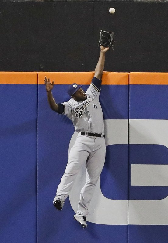 Milwaukee Brewers center fielder Lorenzo Cain (6) catches a ball hit by New York Mets' Todd Frazier for an out during the second inning of a baseball game Friday, April 26, 2019, in New York. (AP Photo/Frank Franklin II)