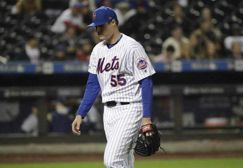 New York Mets relief pitcher Corey Oswalt leaves the field during the fifth inning of a baseball game against the Milwaukee Brewers Friday, April 26, 2019, in New York. (AP Photo/Frank Franklin II)