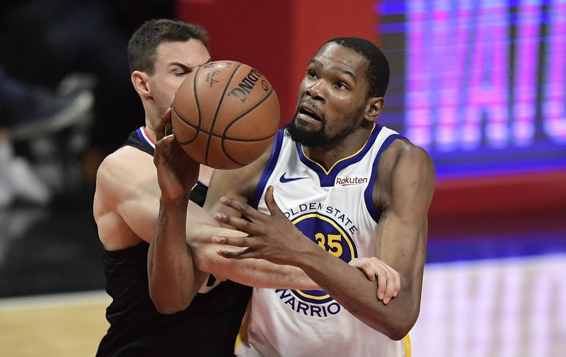 Golden State Warriors forward Kevin Durant, right, is fouled by Los Angeles Clippers forward Danilo Gallinari during the second half in Game 6 of a first-round NBA basketball playoff series Friday, April 26, 2019, in Los Angeles. (AP Photo/Mark J. Terrill)