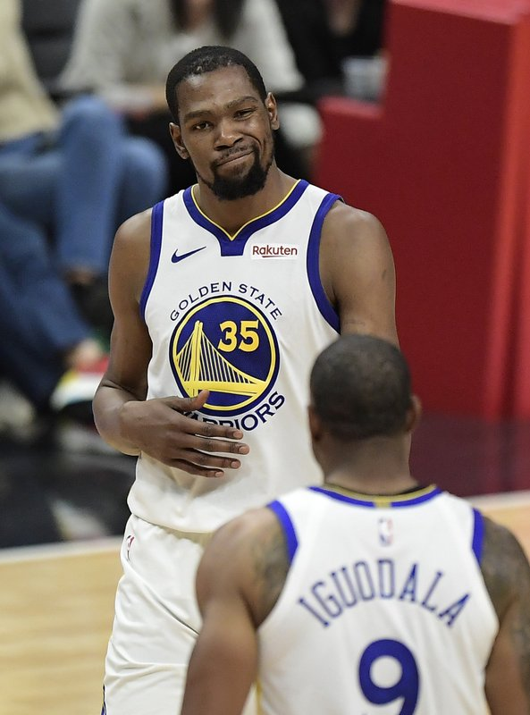 Golden State Warriors forward Kevin Durant, top, winks as guard Andre Iguodala during the second half in Game 6 of a first-round NBA basketball playoff series against the Los Angeles Clippers Friday, April 26, 2019, in Los Angeles. (AP Photo/Mark J. Terrill)