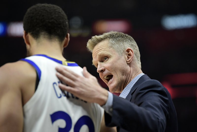 Golden State Warriors head coach Steve Kerr, right, talks with guard Stephen Curry during the second half in Game 6 of a first-round NBA basketball playoff series against the Los Angeles Clippers Friday, April 26, 2019, in Los Angeles. (AP Photo/Mark J. Terrill)