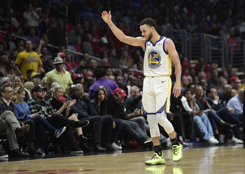 Golden State Warriors guard Stephen Curry eggs on the the crowd after scoring during the second half in Game 6 of a first-round NBA basketball playoff series against the Los Angeles Clippers Friday, April 26, 2019, in Los Angeles. (AP Photo/Mark J. Terrill)