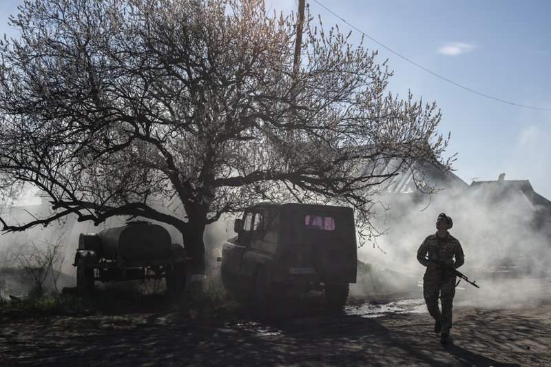 A Ukrainian serviceman guards a position near the frontline as the conflict continues, in Mariinka, Donetsk region, eastern Ukraine, Saturday, April 20, 2019. (AP Photo/Evgeniy Maloletka)
