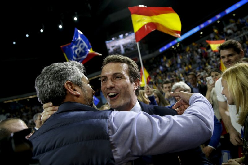 Popular Party's candidate Pablo Casado, right, arrives for the closing election campaign event in Madrid, Spain, Friday, April 26, 2019. (AP Photo/Andrea Comas)