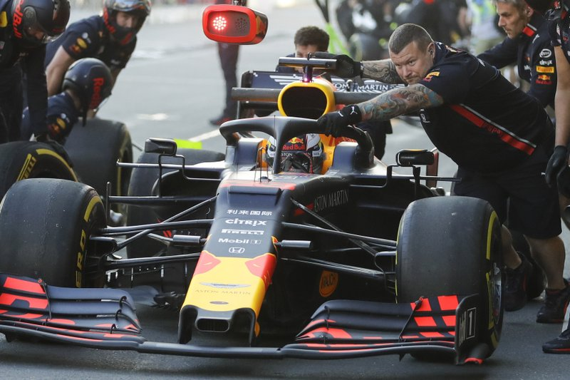 Red Bull's Max Verstappen of the Netherlands stops his car in pit lane during the second free practice at the Baku Formula One city circuit in Baku, Azerbaijan, Friday, April 26, 2019. (AP Photo/Sergei Grits)