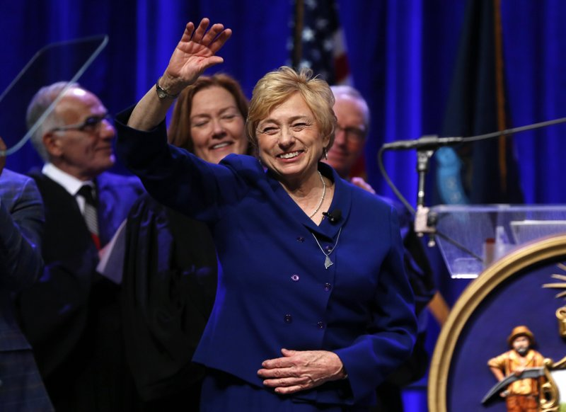 FILE - In this Wednesday, Jan. 2, 2019 file photo, Gov. Janet Mills acknowledges applause after taking the oath of office at the Augusta Civic Center in Augusta, Maine. (AP Photo/Robert F. Bukaty)