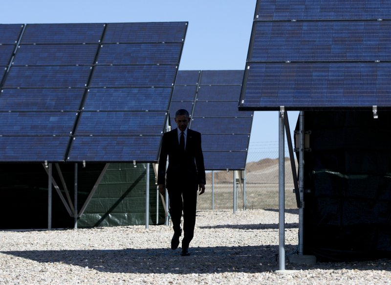 FILE - In this Friday, April 3, 2015 file photo, President Barack Obama walks through a solar array at Hill Air Force Base, Utah to speak about clean energy and the jobs numbers. (AP Photo/Carolyn Kaster)