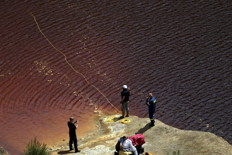 Investigators are searching for bodies with a special camera in a man-made lake near the village of Mitsero outside of the capital Nicosia, Cyprus, Saturday, April 27, 2019. (AP Photo/Petros Karadjias)