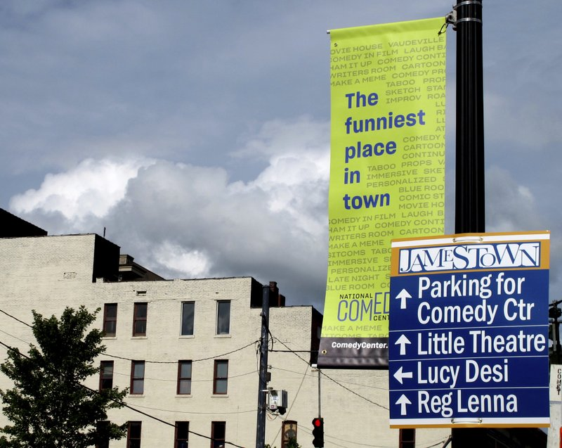 In this July 24, 2018 file photo, street signs in Jamestown, N.Y. promote the National Comedy Center. (AP Photo/Carolyn Thompson)