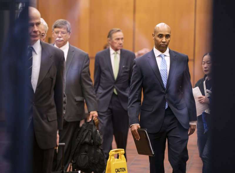 Former Minneapolis police officer Mohamed Noor walks through the elevator lobby of the Hennepin County Government Center with his legal team in Minneapolis on Friday, April 26, 2019. (Leila Navidi/Star Tribune via AP)